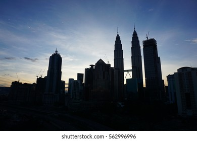 Sunrise in Kuala Lumpur, Malaysia with many buildings background including Petronas Twin Towers
