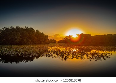 Sunrise at Lake Bradford in Little Creek, Virginia.