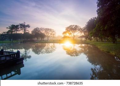 Sunrise at lake with clouds over the sky at Tasik Ilmu UTM Skudai Johor Malaysia.