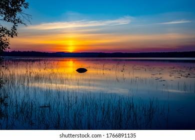 Sunrise and lake. Finnish summer morning lake scene.