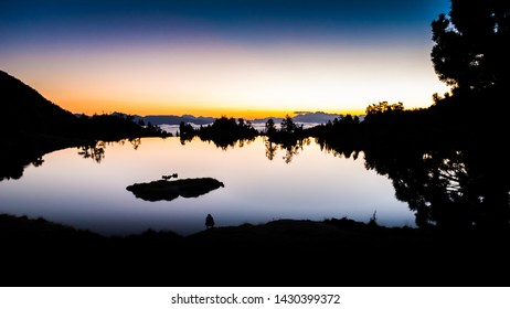 Sunrise lake in the Spanish Pyrenees, located at mountain hut JM Blanc, Aigüestortes i Estany de Sant Maurici national park