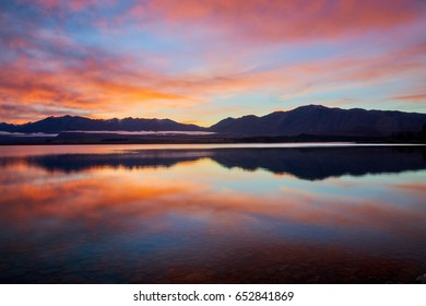 Sunrise at Lake Tekapo with nice reflections - Red Edition