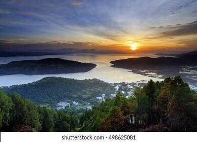 sunrise Lake Toba with views Sibandang island .. and Muara town in North Sumatra
