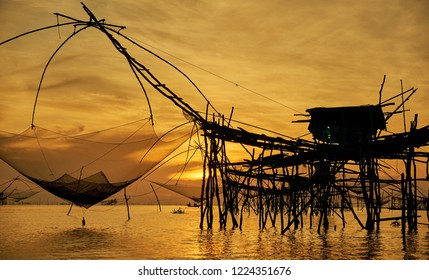 sunrise and large fisherman's tools at Thale noi, Phatthalung, Thailand. silhouette.