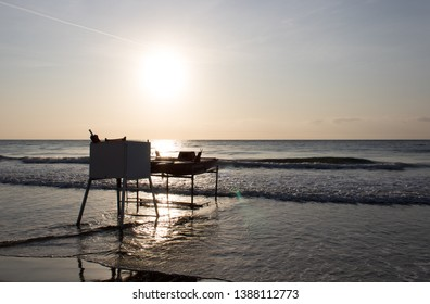 sunrise with life guard seat in alassio italy