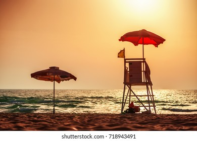 Sunrise with life guard station silhouette. Varna beach, Bulgaria.