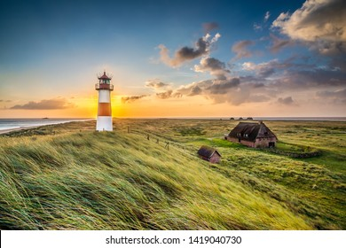 Sunrise at lighthouse in List on the island of Sylt, Schleswig-Holstein, Germany