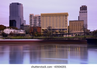 Sunrise in Little Rock, Arkansas. Blurred barque in the foreground.