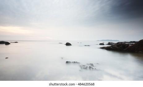 Sunrise - long exposure at Pantai Pandak, Kuala Terengganu. The beach full of beautiful rocks