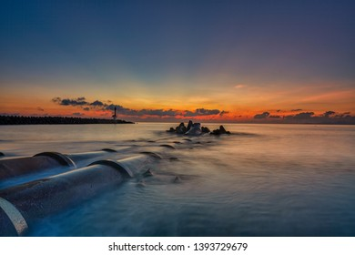 Sunrise long exposure shot at Marang Lighthouse in Terengganu, Malaysia with ray of light and minimal clouds.