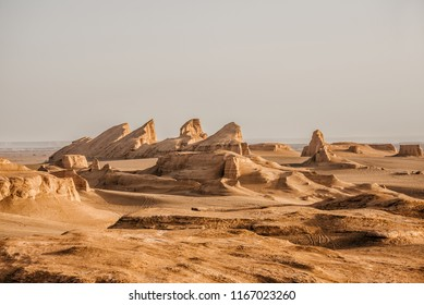 Sunrise in the Lut Desert (also Kalut desert), one of the driest and hottest places in the world.