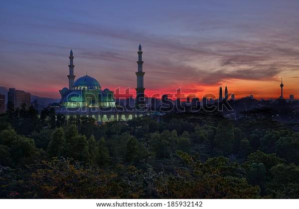 Sunrise at the majestic and iconic Federal Territory Mosque or Masjid Wilayah Persekutuan in Kuala Lumpur, Malaysia.