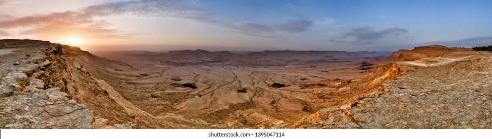 Sunrise at Makhtesh (crater) Ramon, is a geological landform of a large erosion cirque in the Negev Desert, Southern Israel. Panoramic view