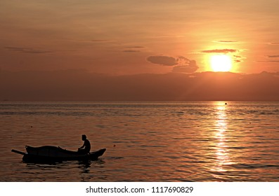 Sunrise and Man In A Boat Silhouette, Perfect for Canvass Print, Wallpaper.
