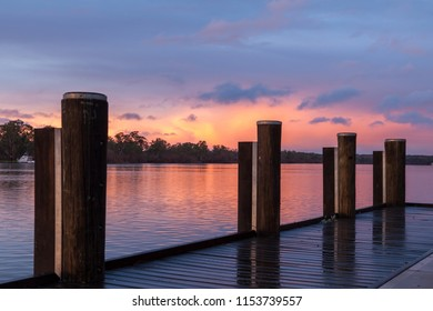 Sunrise at Mannum riverbank, River Murray South Australia with jetty and pink sky.