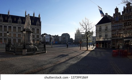 Sunrise at Mechelen's main square, the Grote Markt with long shadows