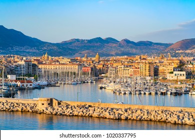 Sunrise at the Mediterranian sea and port at Palermo old city, Sicily, Italy