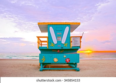Sunrise in Miami Beach Florida, with a colorful lifeguard house in a typical Art Deco architecture, at sunrise with ocean and sky in the background.