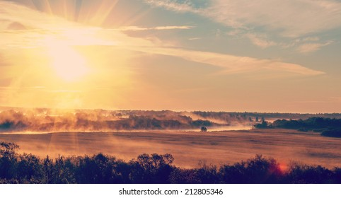 sunrise with the mist over the river and the forest in central Russia in the summer
