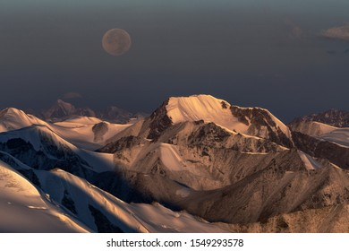 Sunrise and moonset in Tien Shan mountains