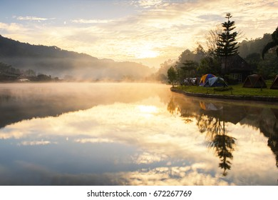 Sunrise with Morning Mist in Cloudy Sky Day at Reservoir , Ban Rak Thai Hilltribe Village, Mae Hong Son, Thailand