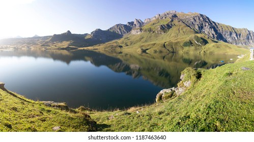 Sunrise morning on Melchsee-Frutt and Blausee in Swiss Alps, Summer
