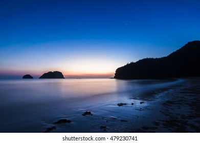 Sunrise in the Morning sea and smooth wave privacy peaceful at Sam Roi Yot Beach Kui Buri Thailand viewpoint landmark