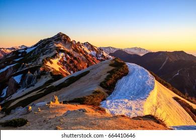 Sunrise at Mount Tsubakuro Dake, famous trekking mountain in Azumino, Nagano Prefecture, Japan. It is situated in Japan's Hida Mountains, Japan Alps in Nagano. It was specified for Chbu-Sangaku Park