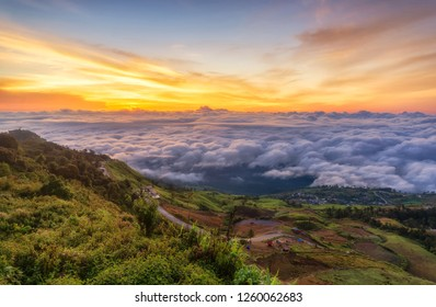 sunrise in the mountain with clouds and fog