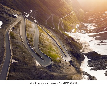 Sunrise at a mountain road in Italy. Stelvio pass, an epic driving road.