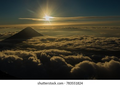 Sunrise in the mountains above sea of clouds