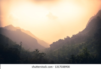Sunrise mountains landscape with fog in the early morning in Sri Lanka nearby Ella mountain rock