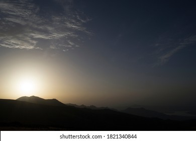 Sunrise in the mountains in the mist creating luminosity and glare of the sun.