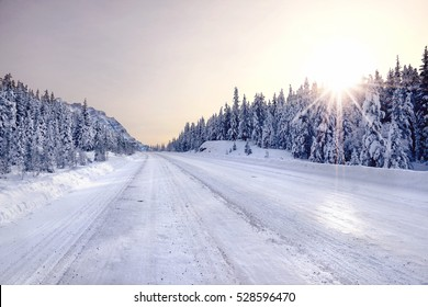 Sunrise in mountains. Scenic view of Icefields Parkway in winter, Alberta, Canada