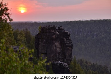 Sunrise nature with rock tower of sandstone.