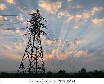 Sunrise near electricity tower