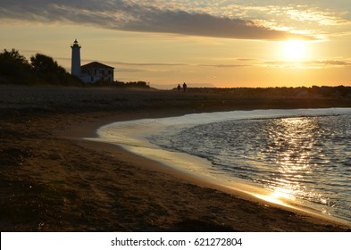 sunrise near the lighthouse at sea