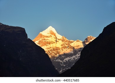 Sunrise. Neelkanth mountain in the Garhwal division of the Himalayas in Uttarakhand glistening in the golden sun. A view from Badrinath one early morning as the first rays of the sun strike it.