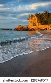Sunrise in Nerja on Costa del Sol in Spain, sea shore and Balcon de Europa.