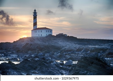 Sunrise next to the Favaritx lighthouse on the Mediterranean island of Menorca in Spain.