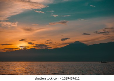 Sunrise in the ocean, Lovina, north of Bali, Indonesia