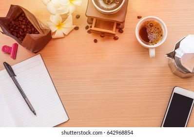 sunrise office with wooden table and  laying on it with coffie