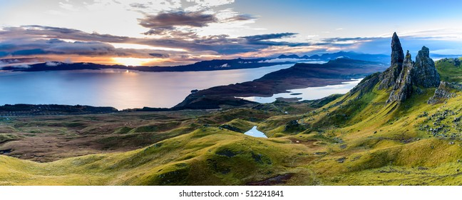 Sunrise at The Old Man of Storr - beautiful panorama of an amazing scenery with vivid colors - symbolic tourist attraction - mystery around the landmark - spectacular panorama with first rays of light