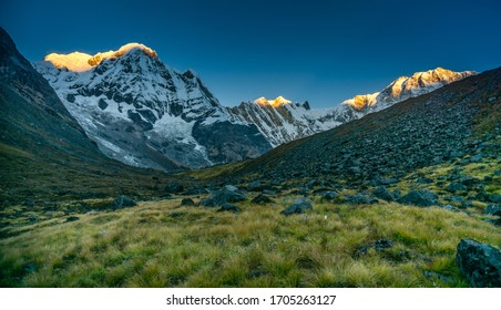 Sunrise on Annapurna range of mountains  and alpine meadow at Annapurna Base Camp in Nepal. Best views of Annapurna Sanctuary trek.