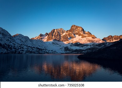 Sunrise on Banner Peak above Garnet Lake in the Ansel Adams wilderness after a fresh snow