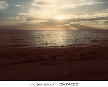Sunrise on the beach and beautiful cloudscape over the sea