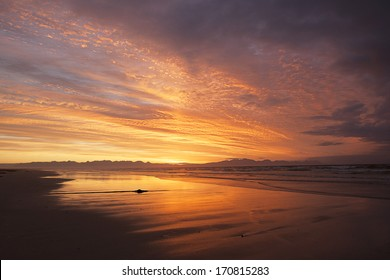 sunrise on the beach in dramatic colors