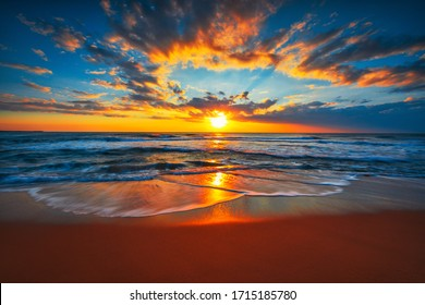 Sunrise on the beach and ocean waves on a tropical sea