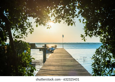 Sunrise on the boardwalk in Bacalar, Mexico