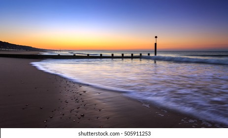 Sunrise on Boscombe beach in Bournemouth, Dorset, UK